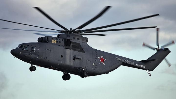 Военный вертолёт, летевший в Новосибирск, экстренно сел в Красноярском крае