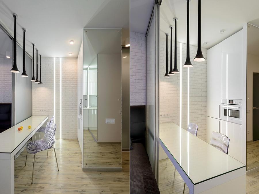Одна стена в квартире выложена тонким гипсовым кирпичом, покрашенным в белый цвет. Световые полосы для кухонной стены заказывали в «Люкс Хаус». Там же куплены черные итальянские светильники фабрики Vistosi — 5 штук стоили около 75 тыс. руб. «Мы всегда проектируем свет так, что у нас есть разные сценарии подсветки — освещение для уединения и более яркий свет, если пришли гости», — описывает архитектор.